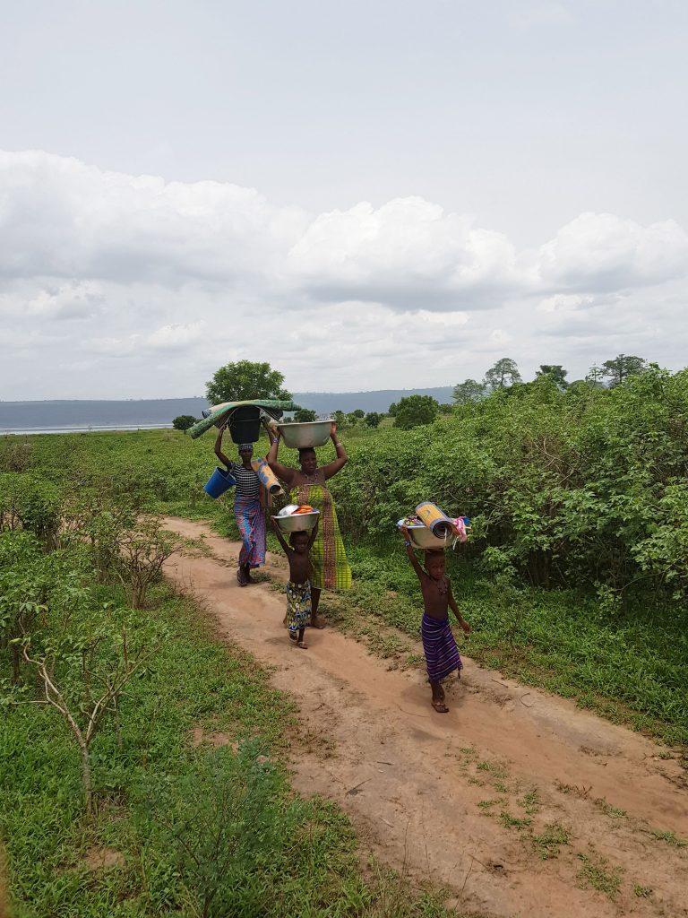 Local women bring the washing from Lake Volta to Ekye